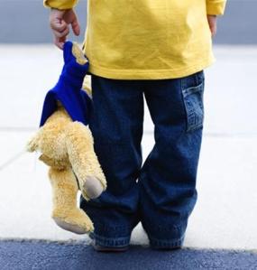 boy holding a teddy bear